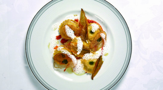 Potato tortelli and buffalo mozzarella with light tomato sauce and droplets of pesto Dop