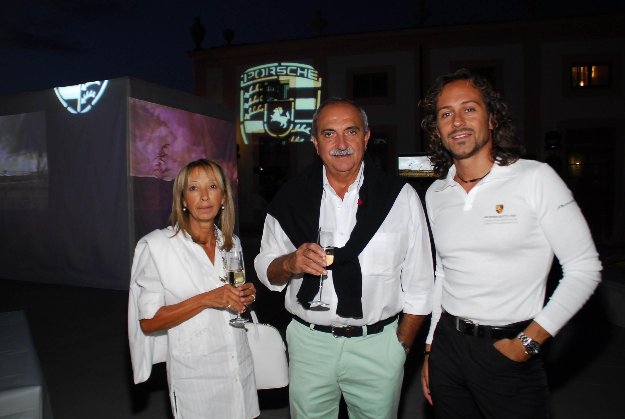PRESSPHOTO  Firenze, Resort Villa Olmi, presentazione Porsche Panamera. Nella foto Simone Pecchioli, Franco Cortesi e Gianna Salocchi